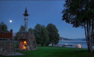 Exterior fireplace with Lake Pend Oreille