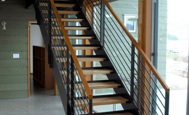 Stair maintains the open feeling of the space